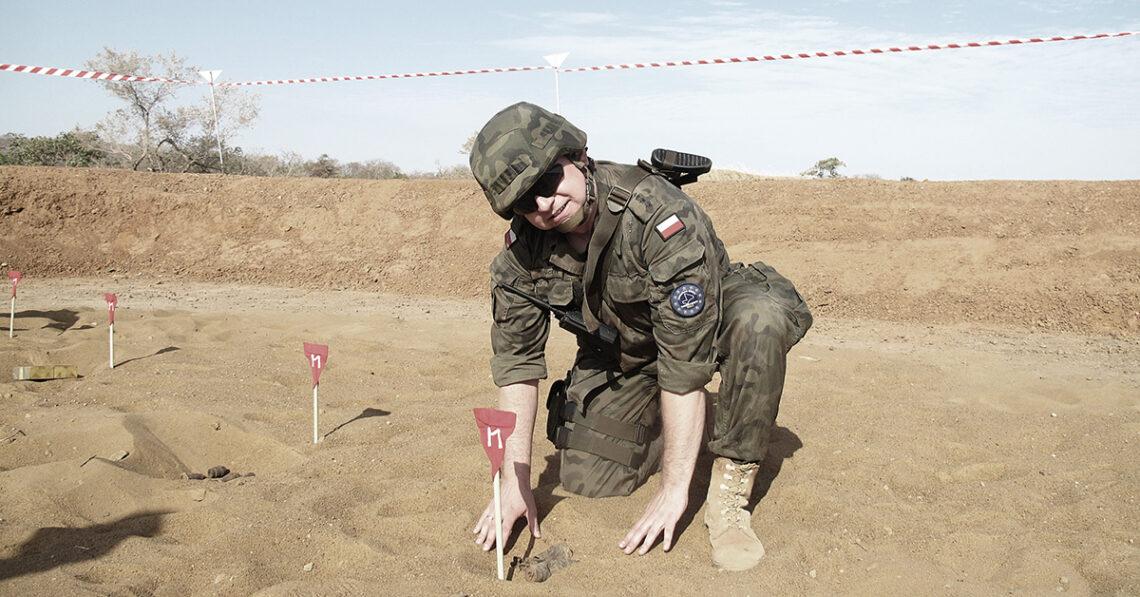 Krzysiek is preparing for disposal of an unexploded ordnance